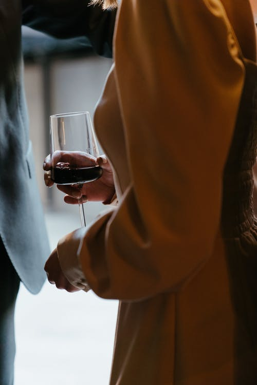 Man in Brown Suit Holding Wine Glass