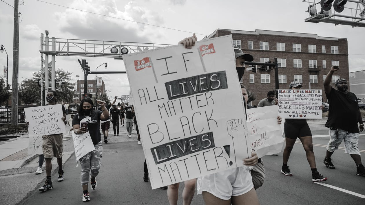 Photo of People Holding Signages