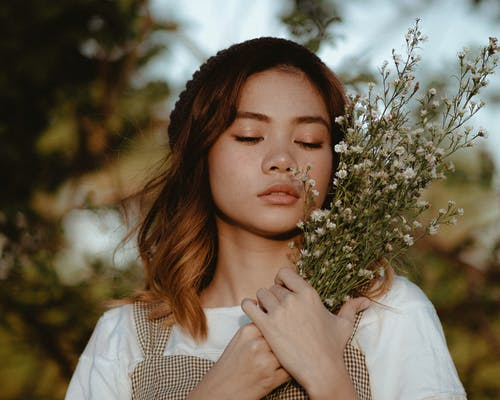 Young beautiful woman with lavender flowers
