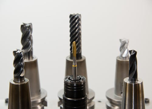 Close Up Photo of Black Metal Drill Bit