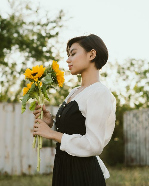 Gentle woman with bouquet of flowers