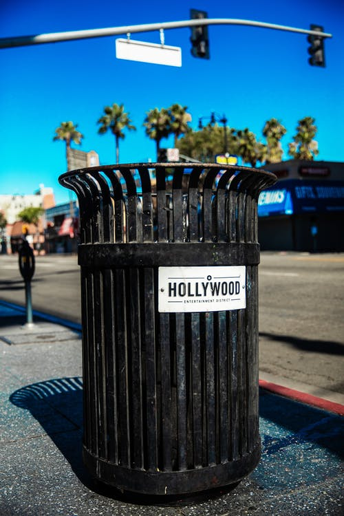 A Close-Up Shot of a Black Trash Can