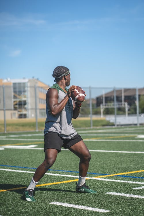 Photo of Man Playing American Football