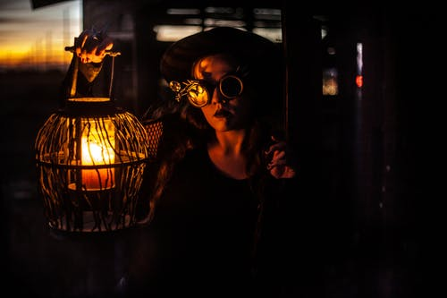Woman With Steampunk Eyeglasses Holding a Lantern