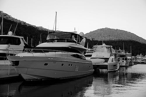 Free stock photo of black and white, boats, water reflections