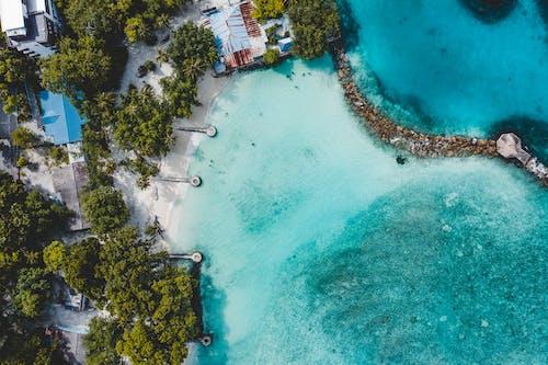 Drone view of azure seawater washing tropical island coast