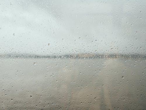 Rain drops on glass window surface