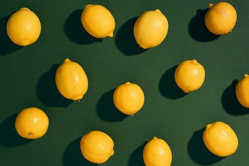 Yellow Lemon Fruits on Black Surface