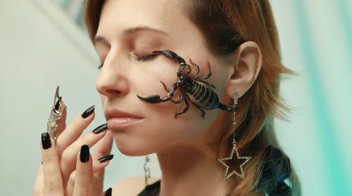 Photo of Scorpion on Woman's Face