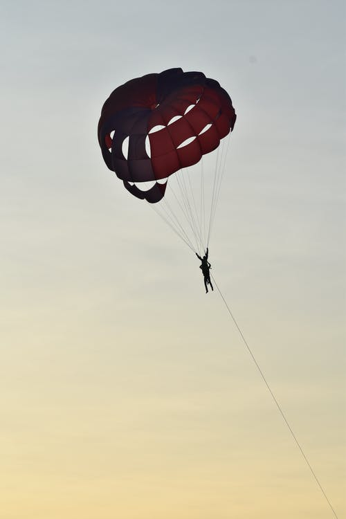 Person Paragliding in Midair