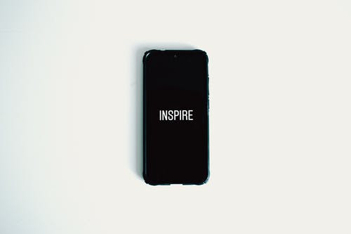 Photo of Black Smartphone Against White Background