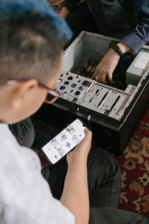 Person Holding White and Black Audio Mixer