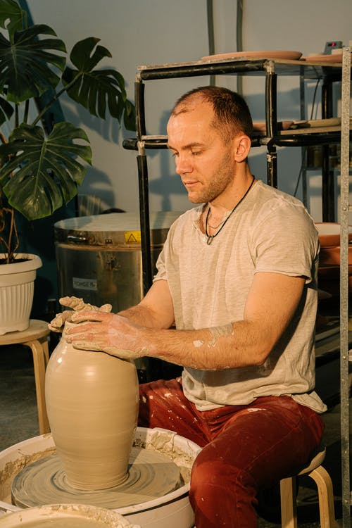 Photo of Man Molding Clay Jar