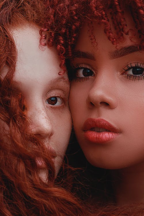 Woman With Red Hair Beside Woman