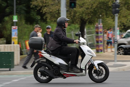 Free stock photo of city, day, man, moped
