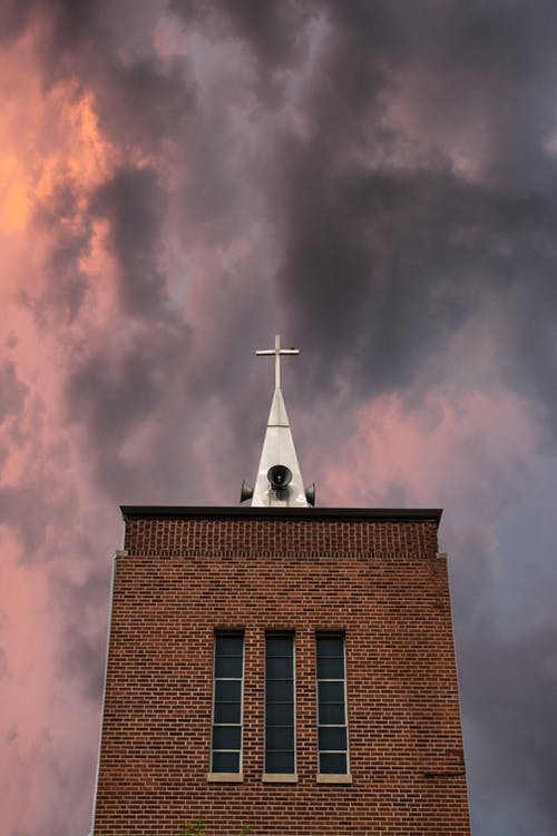 Church against pink overcast sky