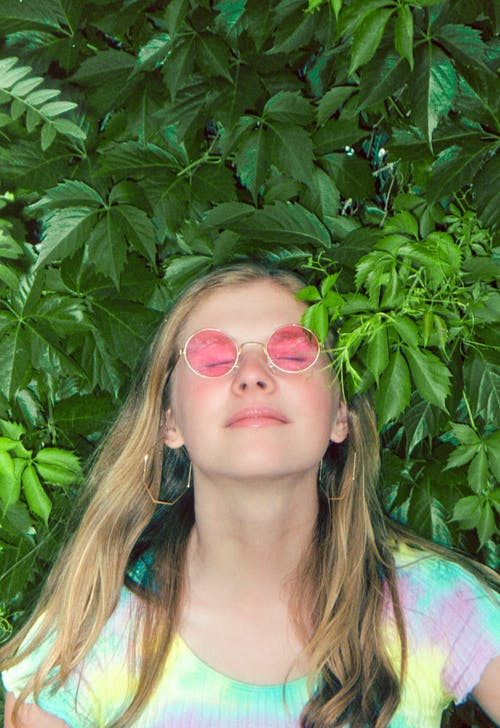 Woman in Green and Pink Floral Shirt Wearing Sunglasses