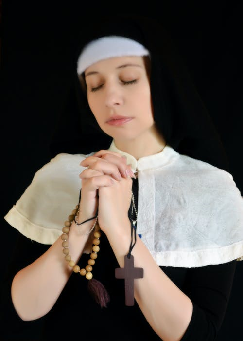 Peaceful nun with cross and rosary