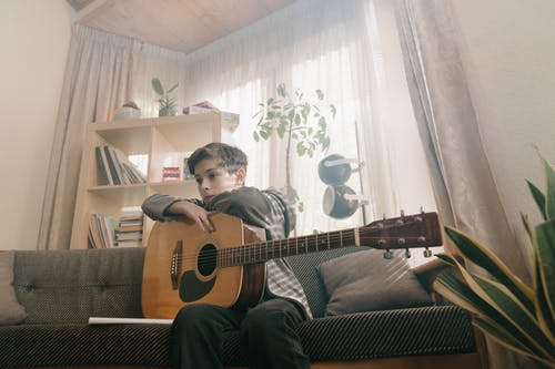 Man in Black Shirt Playing Acoustic Guitar