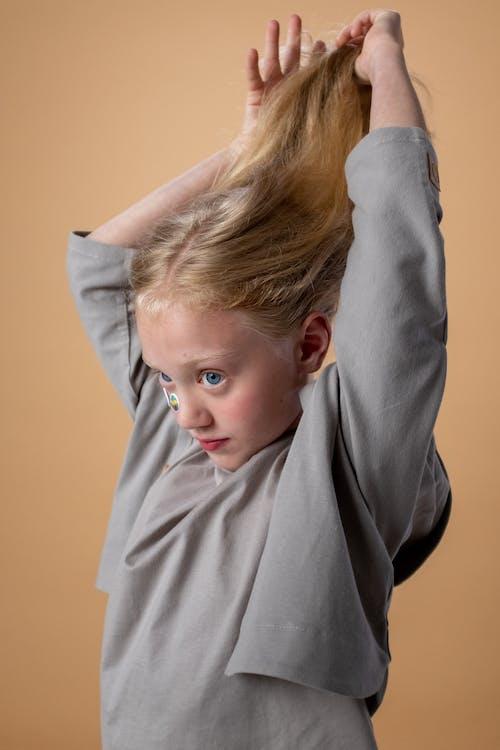 Girl in Gray Turtleneck Sweater