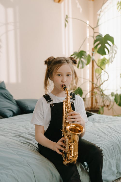 Girl in Black T-shirt Playing Saxophone