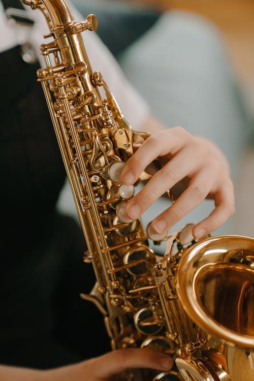 Gold Saxophone in Black Background
