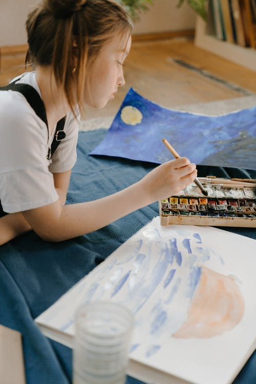 Woman in White T-shirt Painting