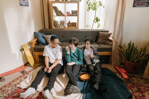 3 Boys Sitting on Couch