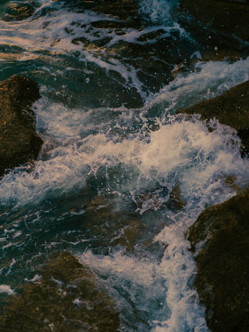 Water Waves Hitting Rocks