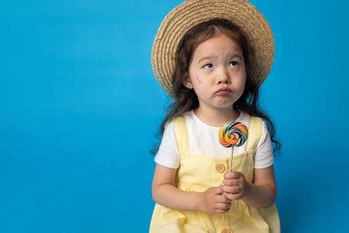 Girl in White Shirt Wearing Brown Straw Hat