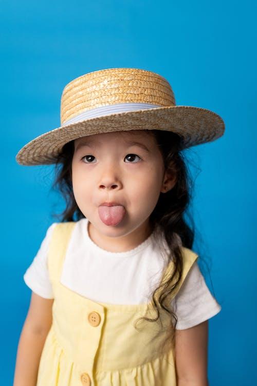 Girl in Yellow Shirt Wearing Brown Hat