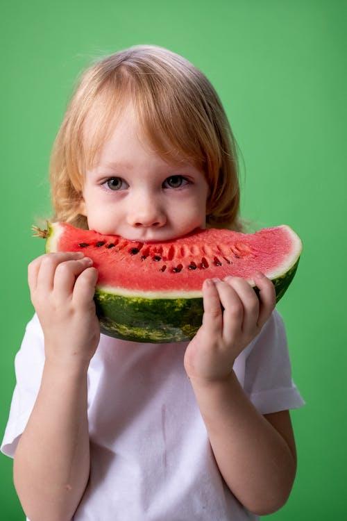 Girl in White Long Sleeve Shirt Holding Watermelon