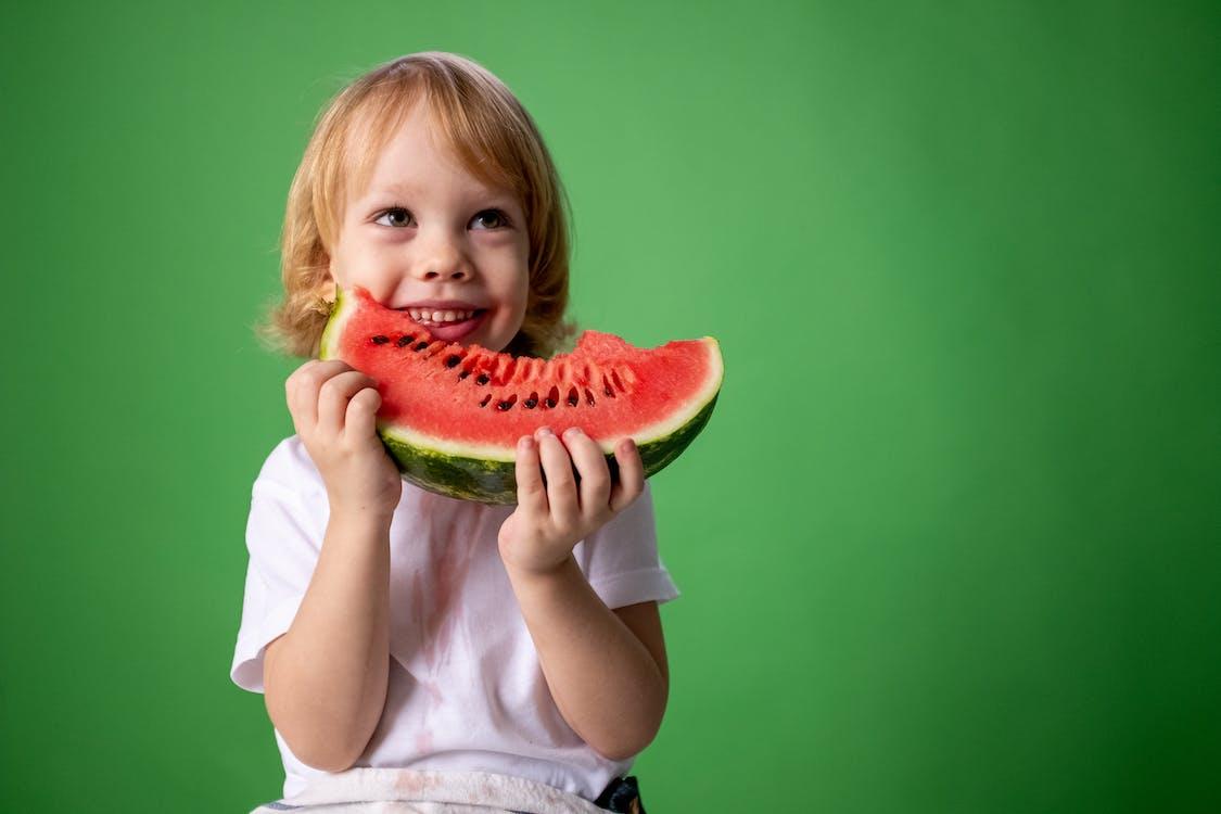 Girl in White Shirt Holding Green Watermelon