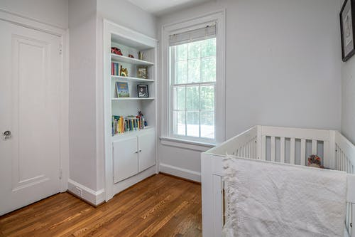 Photo of White Wooden Crib Near White Wall