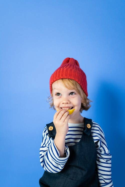 Boy in Red Knit Cap and Black and White Stripe Shirt
