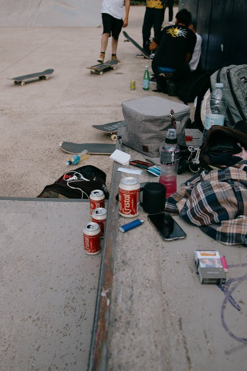 Bottles and cans of drinks of skaters in skate park