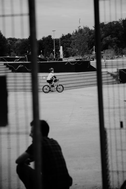 Little boy riding bicycle in park
