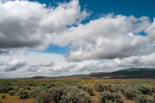 Heavy clouds above meadow and valley