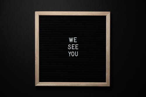Chalkboard with white We See You inscription