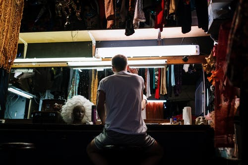Back View of Drag Queen in Dressing Room