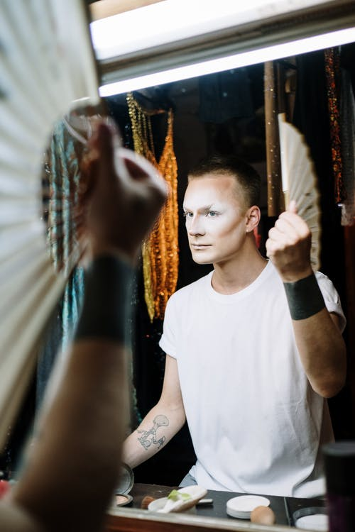 Drag Queen Holding Fan in Dressing Room