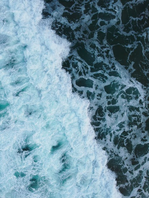 Sea waving with splashing water