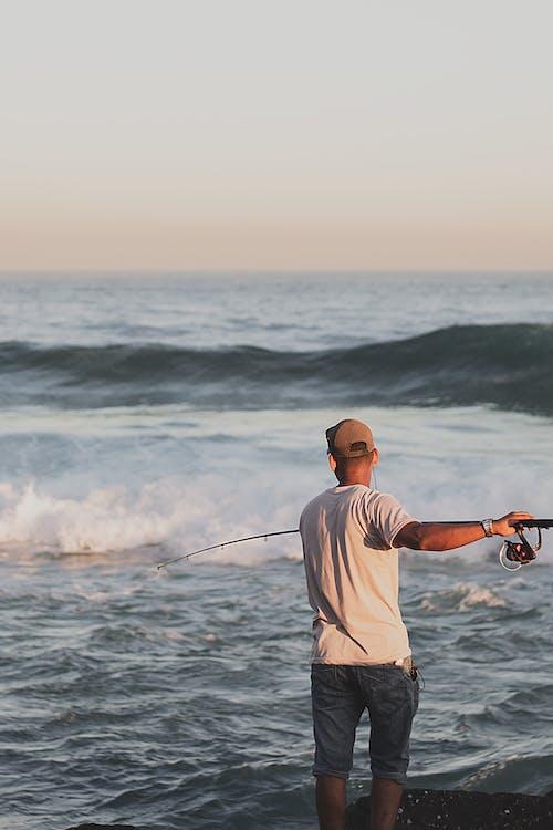 adam, aksiyon, balık, balıkçı içeren Ücretsiz stok fotoğraf