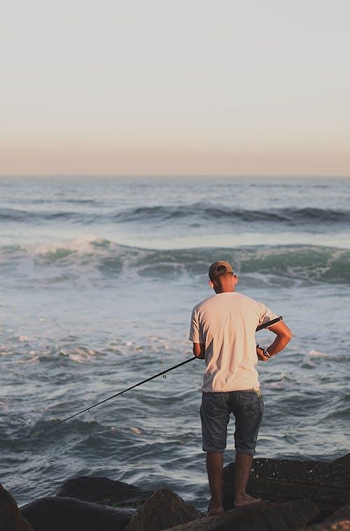 açık hava, adam, balık, balıkçı içeren Ücretsiz stok fotoğraf
