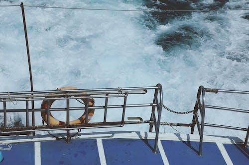 Brown Metal Ladder on Water
