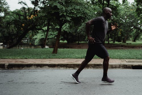 Shallow Focus Photo of Man in Gray Shirt Running