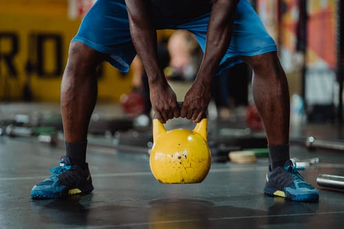 Person Using Kettlebell
