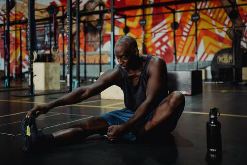 Shallow Focus Photo of Man Stretching