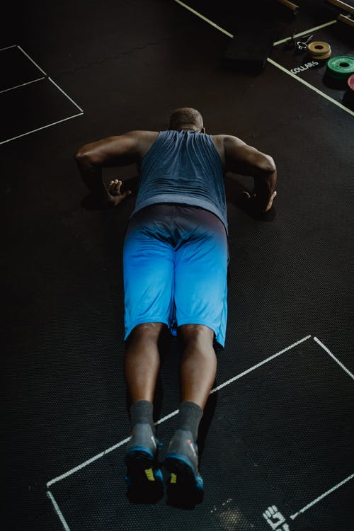 Man in Blue Shorts Doing Push-Ups