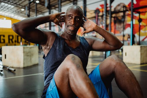 Man in Gray Tank Top Doing Exercise